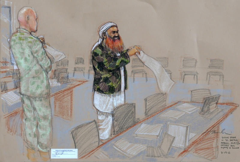 In this pool photo of a sketch by courtroom artist Janet Hamlin and reviewed by the U.S. Department of Defense, the self-proclaimed terrorist mastermind Khalid Sheikh Mohammed, with his gray beard streaked with reddish-orange dye, unfurls a prayer rug during a break in the proceedings of the pretrial hearings at the Guantanamo Bay U.S. Naval Base in Cuba, Monday, Aug. 19, 2013. Five Guantanamo Bay prisoners accused of helping orchestrate the Sept. 11 terrorist attacks returned to court Monday as arguments resumed. Lawyers for the five prisoners, who face charges that include murder and terrorism, began to challenge the statements made to U.S. federal agents such as James Fitzgerald of the FBI and Stephen McClain with the Criminal Investigative Task Force of the Department of Defense, who defended their interrogation of one of the detainees. (AP Photo/Janet Hamlin, Pool)