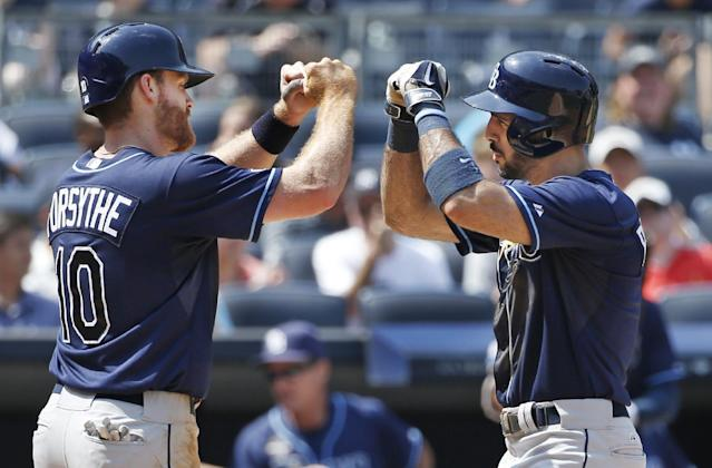 Tampa Bay Rays Logan Forsythe greets the Rays Sean Rodriguez at the plate after scoring on Rodriguez's sixth-inning, two-run home run in a baseball game at Yankee Stadium in New York, Wednesday, July 2, 2014. (AP Photo/Kathy Willens)