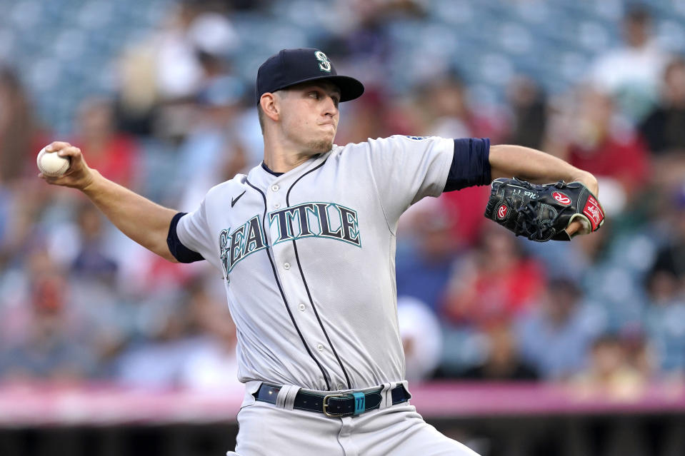 Seattle Mariners starting pitcher Chris Flexen throws to the plate during the first inning of a baseball game against the Los Angeles Angels Friday, July 16, 2021, in Anaheim, Calif. (AP Photo/Mark J. Terrill)