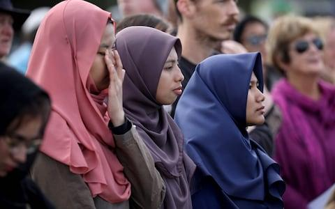 <span>Members of the public react during the National Remembrance Service at North Hagley Park in Christchurch</span> <span>Credit: AFP </span>