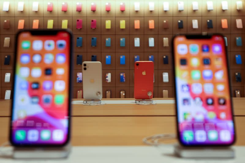 FILE PHOTO: IPhones are displayed at the upcoming Apple Marina Bay Sands store in Singapore