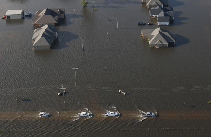 <p>Cars drive through flooded streets from Tropical Storm Harvey in Orange, Texas, Thursday, Aug. 31, 2017. (Photo: Gerald Herbert/AP) </p>