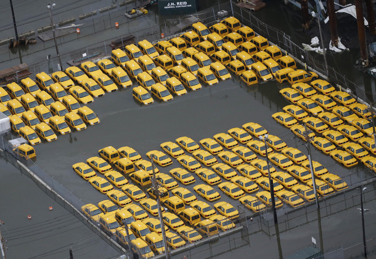 Taxis are submerged in floodwaters in the wake of superstorm Sandy on Tuesday, Oct. 30, 2012, in Weehawken, N.J. Sandy, the storm that made landfall Monday, caused multiple fatalities, halted mass transit and cut power to more than 6 million homes and businesses. (AP Photo/Mike Groll)