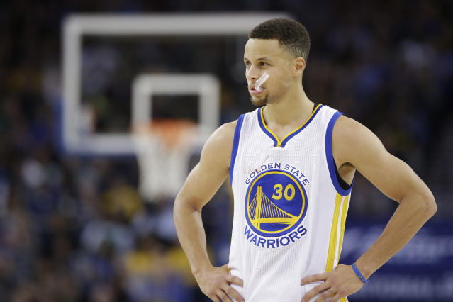 Steph Curry probably should have practiced his golf swing outside. (AP Photo)