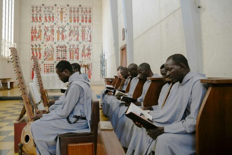 Monks at Keur Moussa sing accompanied by the kora instead of an organ