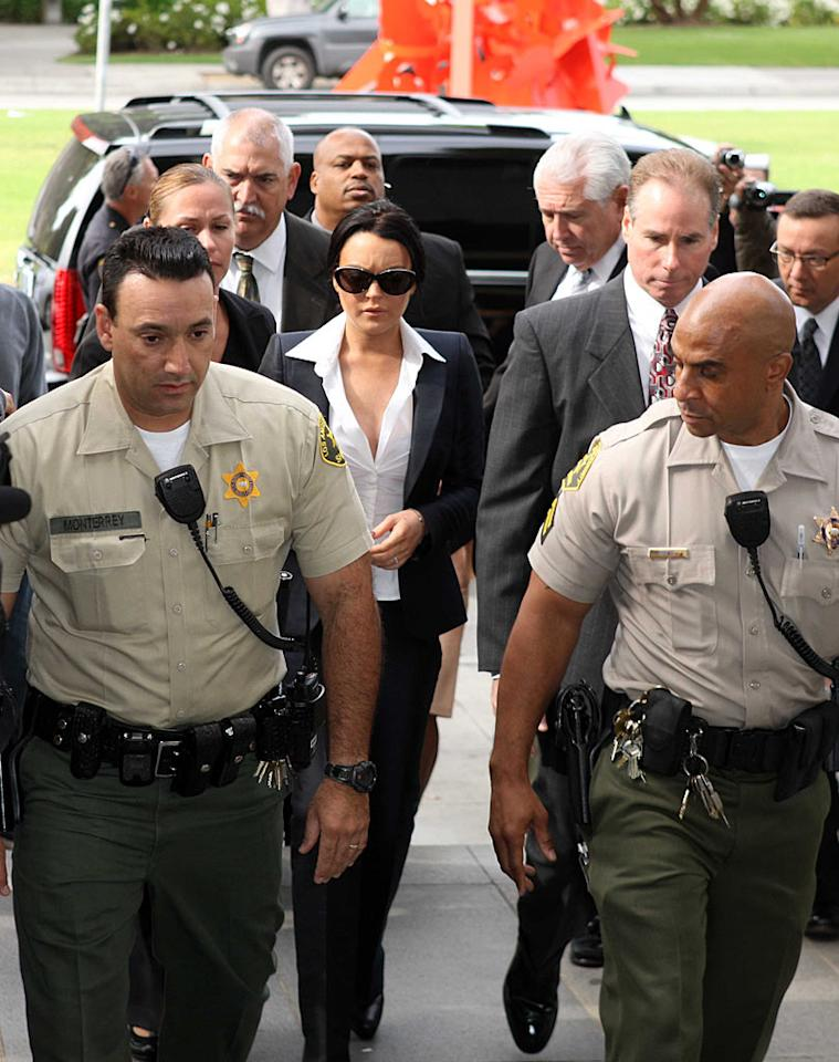 """Eventually, Lindsay made it back to Beverly Hills for her delayed court appearance. Though she narrowly avoided jail time, the judge ordered Lohan to wear a SCRAM alcohol-monitoring bracelet, avoid drinking alcohol, submit to random drug testing once a week, and attend the remainder of her alcohol education classes at a rate of one per week. Deano/<a href=""""http://www.splashnewsonline.com"""" target=""""new"""">Splash News</a> - May 24, 2010"""