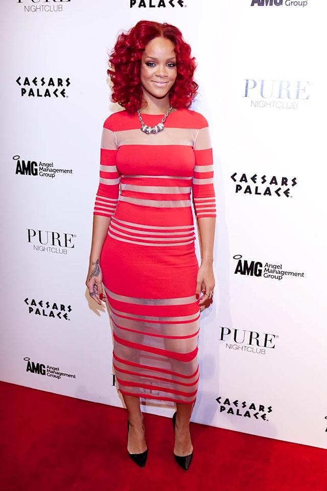 """In addition to ditching that disastrous, Ronald McDonald-esque 'do, Rihanna should also consider dumping the sheer Louise Goldin dress she wore while hosting New Year's Eve at Pure Nightclub in Sin City. David Tingey/<a href=""""http://www.splashnewsonline.com"""" target=""""new"""">Splash News</a> - December 31, 2010"""