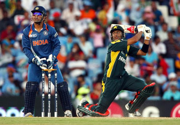 Mahendra Singh Dhoni of India watches on as Shoaib Malik hits out during The ICC Champions Trophy Group A Match between India and Pakistan on September 26, 2009 at The Supersport Stadium in Centurion, South Africa.  (Photo by Julian Herbert/Getty Images) *** Local Caption *** Mahendra Singh Dhoni;Shoaib Malik