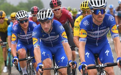 <span>Elia Viviani (centre) does a fine impression of a mountain domestique, the sprinter riding on behalf of team leader Julian Alaphilippe</span> <span>Credit: Getty Images </span>