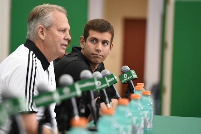 Celtics coach Brad Stevens looks toward team president Danny Ainge during a news conference. The Celtics have some more moves to make after luring Gordon Hayward to Boston. (Getty)
