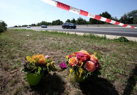 FILE PHOTO: Flowers and candles are placed at the site where a refrigerated truck with decomposing bodies was found by an Austrian motorway patrol near the Hungarian border, near Parndorf, Austria, August 28, 2015. REUTERS/Heinz-Peter Bader/File Photo