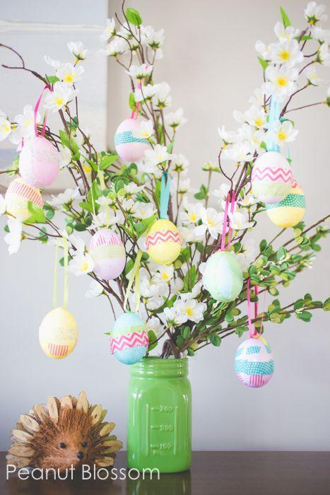"<p>Hang your decorated Easter eggs on a sprigs of silk flowers for a festive ""tree.""</p><p><strong>Get the tutorial at <a href=""http://www.peanutblossom.com/blog/2015/03/easter-egg-tree.html/"" rel=""nofollow noopener"" target=""_blank"" data-ylk=""slk:Peanut Blossom"" class=""link rapid-noclick-resp"">Peanut Blossom</a>. </strong></p>"