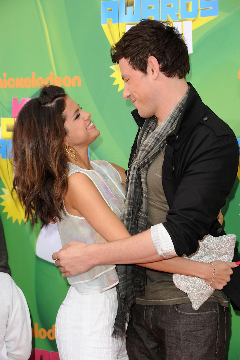 """<p>She shared a sweet hug with <a class=""""link rapid-noclick-resp"""" href=""""https://www.popsugar.com/Cory-Monteith"""" rel=""""nofollow noopener"""" target=""""_blank"""" data-ylk=""""slk:Cory Monteith"""">Cory Monteith</a> on the Kids' Choice Awards red carpet in LA.</p>"""