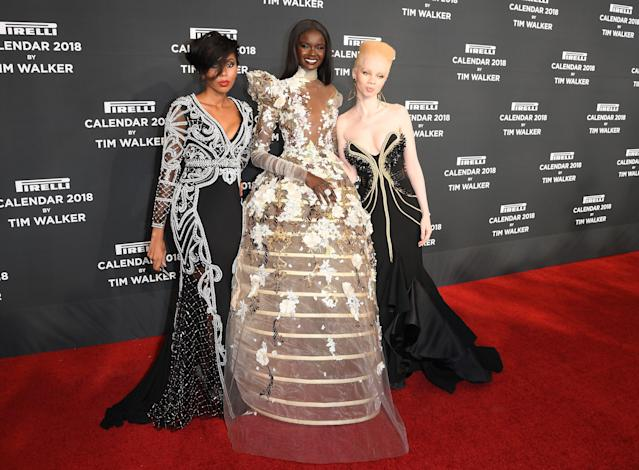 Pirelli 2018 calendar models Jaha Dukureh, Duckie Thot, and Thando Hopa on the red carpet. (Photo: Getty Images)