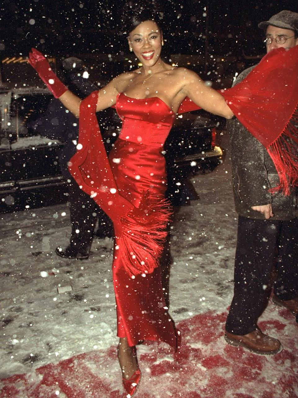 <p>Have you ever seen a more glamorous holiday look? Rochon struck the perfect balance between classic and sexy in this fitted red bustier dress, accented with a red shawl and gloves to match. </p>
