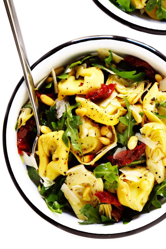"<strong><a href=""https://www.gimmesomeoven.com/tortellini-pasta-salad-with-sun-dried-tomatoes-and-artichokes/"" rel=""nofollow noopener"" target=""_blank"" data-ylk=""slk:Get the&nbsp;Tortellini Pasta Salad With Sun-Dried Tomatoes and Artichokes recipe from Gimme Some Oven"" class=""link rapid-noclick-resp"">Get the&nbsp;Tortellini Pasta Salad With Sun-Dried Tomatoes and Artichokes recipe from Gimme Some Oven</a></strong>"