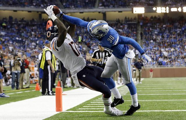 Chicago Bears wide receiver Alshon Jeffery (17), defended by Detroit Lions cornerback Darius Slay (30), scores on a 14-yard reception during the fourth quarter of an NFL football game at Ford Field in Detroit, Sunday, Sept. 29, 2013. (AP Photo/Carlos Osorio)
