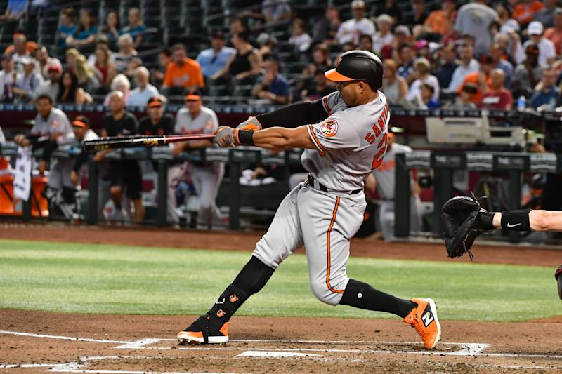 Jul 24, 2019; Phoenix, AZ, USA; Baltimore Orioles right fielder Anthony Santander (25) hits a solo home run in the fourth inningagainst the Arizona Diamondbacks at Chase Field. Mandatory Credit: Matt Kartozian-USA TODAY Sports