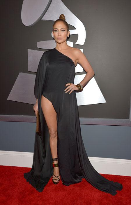 "Jennifer Lopez doesn't care for rules! The singer disregarded the Grammy memo about not wearing revealing clothes telling Ryan Seacrest ""They didn't say anything about leg"" about the thigh-high slit on her sexy dress. But she better watch how she walks or else she might have a ""Angelina Jolie leg"" moment! (Photo by Lester Cohen/WireImage)"