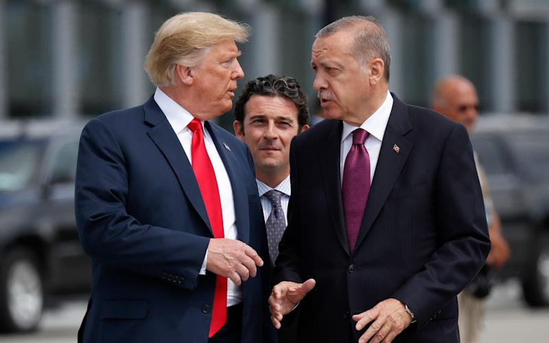 President Donald Trump, left, talks with Turkey's President Recep Tayyip Erdogan, as they arrive together for a summit of heads of state and government at NATO headquarters in Brussels - AP
