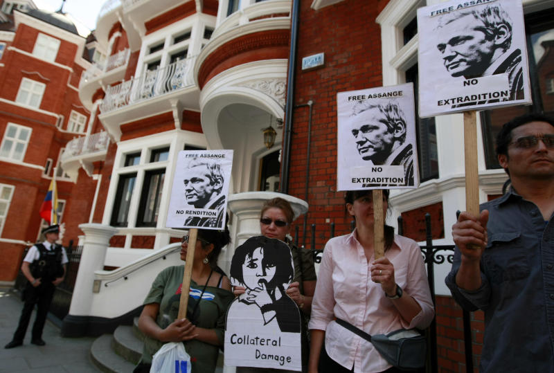 "Demonstrators protest outside the Ecuadorian embassy, London, Wednesday June 20, 2012. WikiLeaks founder Julian Assange entered the embassy Tuesday in an attempt to gain political asylum. Ecuador said Assange would ""remain at the embassy, under the protection of the Ecuadorean government"" while authorities in the capital, Quito, considered his case. Assange was arrested in London in December 2010 at Sweden's request. Since then he has been fighting extradition to the Scandinavian country, where he is wanted for questioning over alleged sexual assaults on two women in 2010. (AP Photo/Tim Hales)"