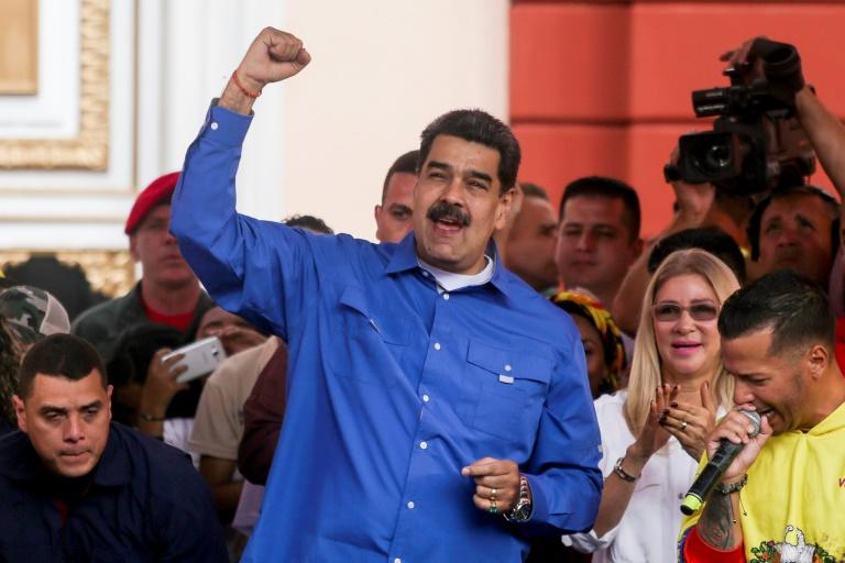 Venezuelan president Nicolas Maduro, with his wife Cilia Flores, speaks during a march for International Youth Day in Caracas, Venezuela on February 12, 2020
