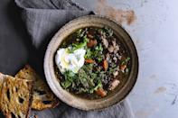 """Any type of lentil will work in this weeknight soup. Or, substitute a couple cans of cannellini beans in their place. <a href=""""https://www.bonappetit.com/recipe/lentil-soup-sausage-mustard-greens?mbid=synd_yahoo_rss"""" rel=""""nofollow noopener"""" target=""""_blank"""" data-ylk=""""slk:See recipe."""" class=""""link rapid-noclick-resp"""">See recipe.</a>"""