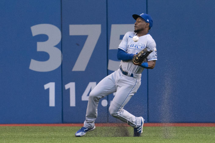 Kansas City Royals right fielder Jarrod Dyson (1) bobbles a ball off the bat of Toronto Blue Jays' Vladimir Guerrero Jr. during a baseball game Friday, July 30, 2021, in Toronto. The Blue Jays were playing in Toronto for the first time since the COVID-19 pandemic began. (Peter Power/The Canadian Press via AP)