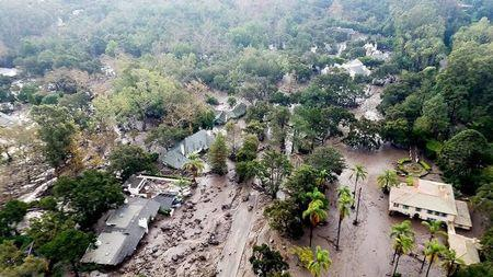 Mudflow and damage from mudslides are pictured in this aerial photo taken from a Santa Barbara County Air Support Unit Fire Copter over Montecito, California January 10, 2018.  Matt Udkow/Santa Barbara County FD/Handout via REUTERS