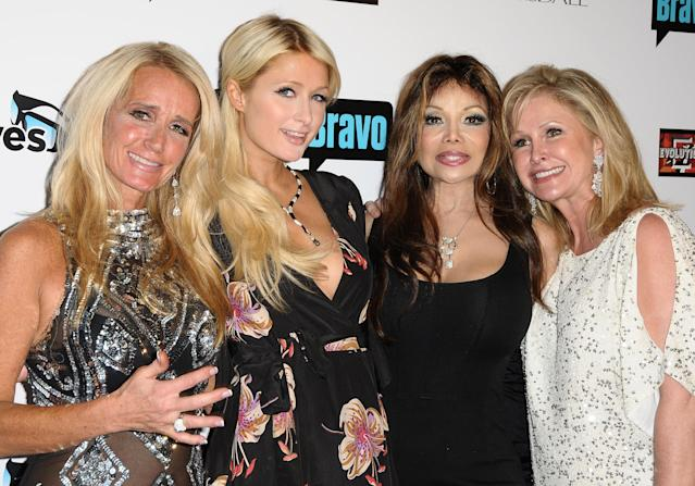 Kim Richards, Paris Hilton, La Toya Jackson, and Kathy Hilton attend the premiere party in 2010 for <em>The Real Housewives of Beverly Hills</em> in Los Angeles. (Photo: Jason LaVeris/Getty Images)