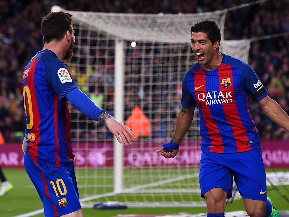 Messi scored twice and Suarez added another as Barcelona kept the pressure on the title race: Getty