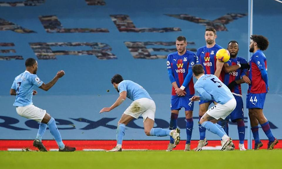 Raheem Sterling (left) scores Manchester City's fourth goal with a superb free-kick.