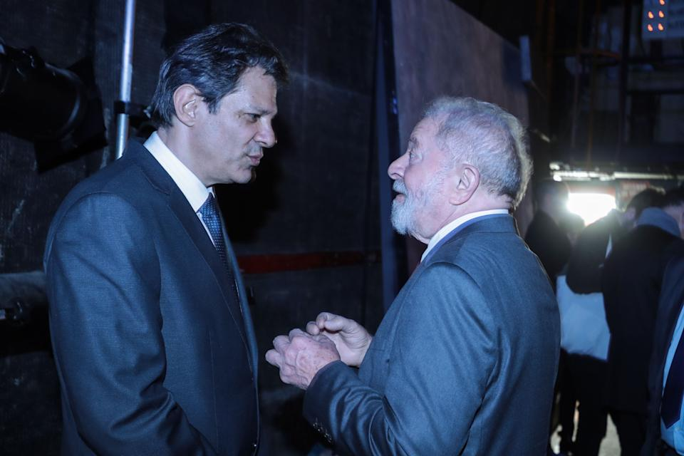 Former Brazilian president Luiz Inacio Lula da Silva (R) speaks with former Sao Paolo Mayor Fernando Haddad prior to a campaign meeting of Paris Mayor and candidate for re-election Anne Hidalgo (hiden) at the Theatre du Gymnase in Paris, on March 2, 2020, ahead of March 2020 mayoral elections in France. - France votes in municipal elections on March 15 and 22, 2020. (Photo by JOEL SAGET / AFP) (Photo by JOEL SAGET/AFP via Getty Images)