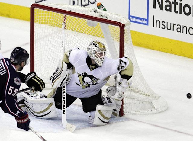 Pittsburgh Penguins' Jeff Zatkoff, right, makes a save against Columbus Blue Jackets' Mark Letestu during the third period of an NHL hockey game Sunday, Dec. 29, 2013, in Columbus, Ohio. The Penguins won 5-3. (AP Photo/Jay LaPrete)