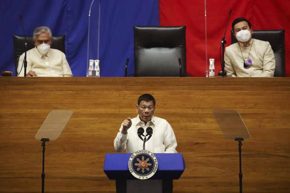 Philippine President Rodrigo Duterte, center, delivers his final State of the Nation Address as Senate President Vicente Sotto III, left, and House Speaker Lord Allan Velasco listens at the House of Representatives in Quezon City, Philippines on Monday, July 26, 2021. Duterte delivered his final State of the Nation speech Monday before Congress, winding down his six-year term amid a raging pandemic, a battered economy and a legacy overshadowed by a bloody anti-drug crackdown that set off complaints of mass murder before the International Criminal Court. (Lisa Marie David/Pool Photo via AP)