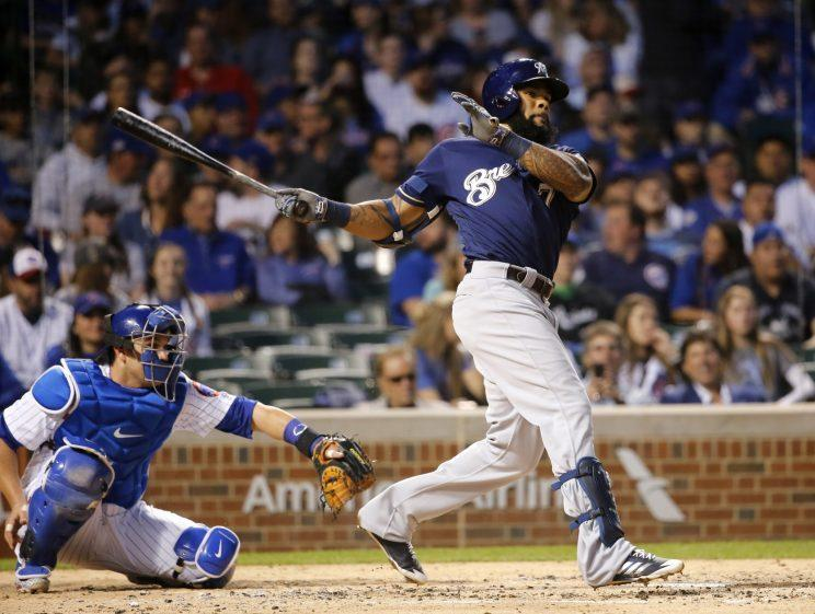 Milwaukee Brewers' Eric Thames hits a double off Chicago Cubs starting pitcher Brett Anderson during the third inning of a baseball game Tuesday, April 18, 2017, in Chicago. (AP Photo/Charles Rex Arbogast)