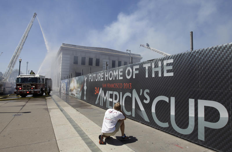 FILE - In this June 20, 2012, file photo, firefighters with the San Francisco Fire Department battle a fire at Pier 29 on the waterfront in San Francisco. The accidental fire was started by a welder who was working on America's Cup improvements, causing $2.4 million in damages to the city pier. (AP Photo/Paul Sakuma, File)