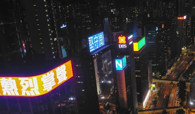 Messages on commercial towers in Causeway Bay called on people to show their appreciation for Hong Kong's medical staff. Photo: Martin Chan