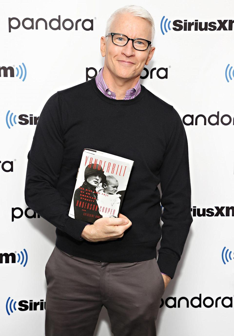 <p>Anderson Cooper holds his new tome on Sept. 22 ahead of an interview on SiriusXM in New York City.</p>