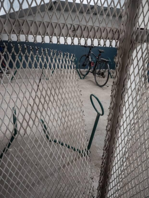 After cutting through the parkade gate, thieves then cut through the metal bike cage in Diane Selkirk's condo building.