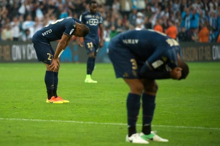 Bastia's players react at the final whistle of the French L1 football match between Marseille and Bastia on May 20, 2017, at the Velodrome stadium in Marseille, southern France