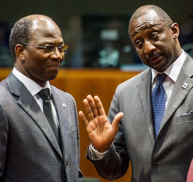 CORRECTING TO IDENTITY AT LEFT to BURKINA FASO'S FOREIGN MINISTER DJIBRIL BASSOLE - Mali's Foreign Affairs Minister Tieman Coulibaly, right, gestures as he talks with Burkina Faso's Foreign Minister Djibril Bassole upon arrival for a ministerial meeting of the support and follow-up group on the situation in Mali, at the European Council building in Brussels, Tuesday, Feb. 5, 2013. Governments and international organizations meet on Tuesday to find ways to reinforce military gains against Islamist rebels in Northern Mali, by supporting democracy, economic development, and human rights in one of the world's poorest countries. (AP Photo/Geert Vanden Wijngaert)