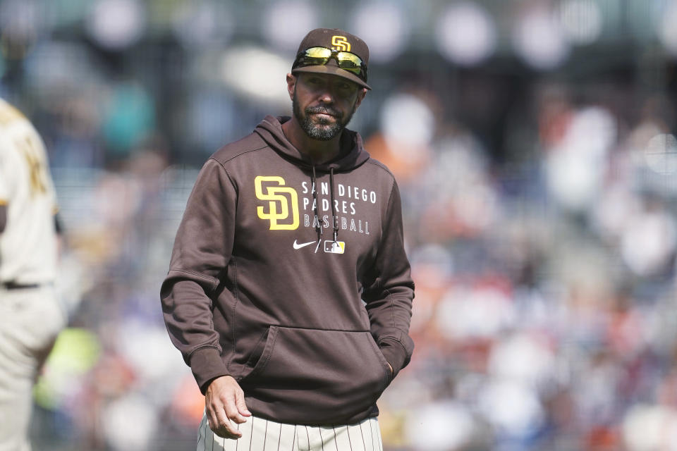 San Diego Padres manager Jayce Tingler walks to the dugout after making a pitching change during the sixth inning of the team's baseball game against the San Francisco Giants in San Francisco, Thursday, Sept. 16, 2021. (AP Photo/Jeff Chiu)