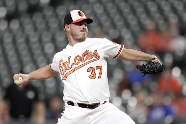 Baltimore Orioles starting pitcher Dylan Bundy throws to a Toronto Blue Jays batter during the first inning of a baseball game, Wednesday, Sept. 18, 2019, in Baltimore. (AP Photo/Julio Cortez)
