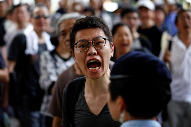 <p>A man yells at pro-China supporters facing pro-democracy supporters, during a march, marking the 20th anniversary of Hong Kong's handover to Chinese sovereignty from British rule, in Hong Kong, China, July 1, 2017. (Photo: Damir Sagolj/Reuters) </p>