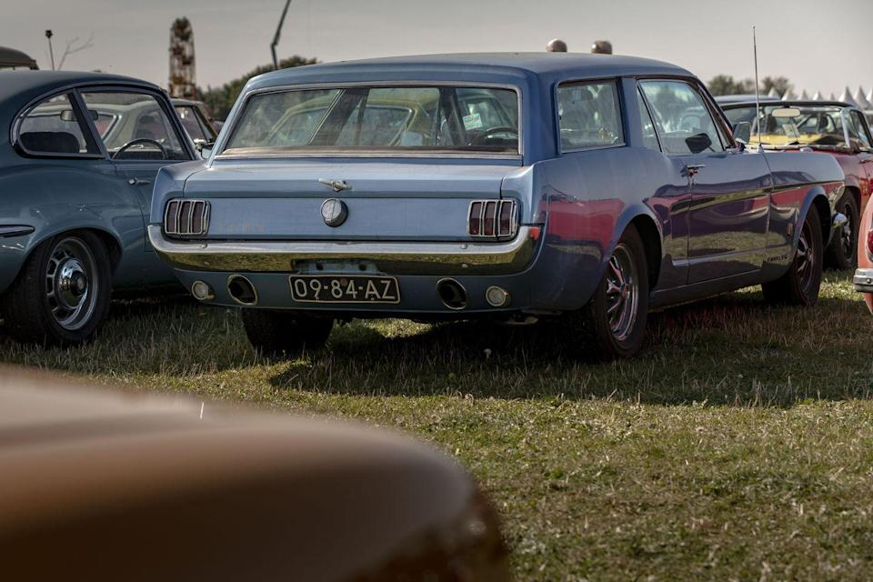 """<p>And then there was this, a Ford Mustang Shooting Brake. In 1965, a couple of literal Mad Men from Ford's ad agency <a href=""""https://www.allfordmustangs.com/threads/1965-mustang-wagon-yay-or-nay.1089648/"""" rel=""""nofollow noopener"""" target=""""_blank"""" data-ylk=""""slk:J Walter Thompson commissioned Italy's Intermecanica"""" class=""""link rapid-noclick-resp"""">J Walter Thompson commissioned Italy's Intermecanica</a> to turn the then-new Mustang into a wagon. When they showed Ford the result and Ford said, """"No, thank you,"""" that car disappeared. The Mustang wagons that show up exceedingly occasionally on eBay or at car shows are often homemade jobs because someone paired the question, """"What if . . ."""" with a glass of some bold Italian red. The Revival parking lot is row after row of these gems, and one of the only places in the world where you'd think, """"Well, why wouldn't that be in the parking lot?""""</p>"""