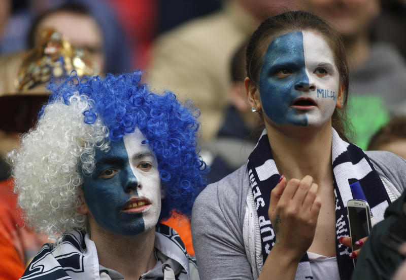 Millwall supporters look on from the stand before the start of their English FA Cup semifinal soccer match against Wigan Athletic at Wembley Stadium in London, Saturday, April 13, 2013. (AP Photo/Sang Tan)