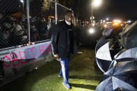 Michael Odiari argues with demonstrators to stop attempting to agitate authorities by advancing on a perimeter security fence during a protest decrying the shooting death of Daunte Wright outside the Brooklyn Center Police Department, Wednesday, April 14, 2021, in Brooklyn Center, Minn. (AP Photo/John Minchillo)