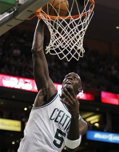 Boston Celtics' Kevin Garnett (5) dunks during the first quarter of Game 4 in an NBA basketball first-round playoff series against the Atlanta Hawks, in Boston on Sunday, May 6, 2012. (AP Photo/Michael Dwyer)