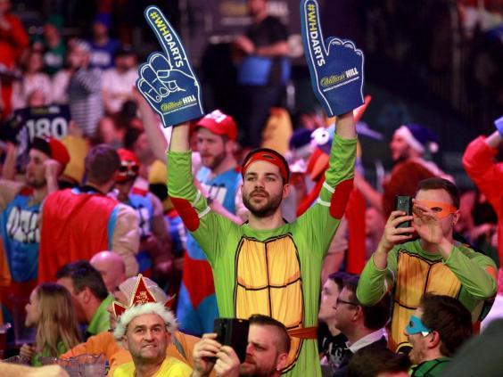 Fans flock to the Alexandra Palace for three wees for the darts (EPA)